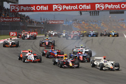 Vitaly Petrov leads the field into turn one on the opening lap of the race