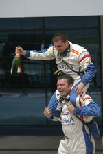 Barwa International Campos Team mechanics celebrate Vitaly Petrov second position