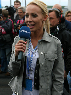 Cora Schumacher, wife of Ralf Schumacher, working on the grid for DTM TV
