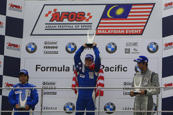 Round 6 podium: Ryuichi Nara (Team E-Rain), Sean McDonagh (Team E-Rain) and Kazeem Manzur (Mahara)