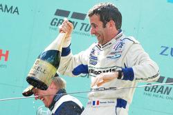 Podium: Romain Dumas is doused in champagne