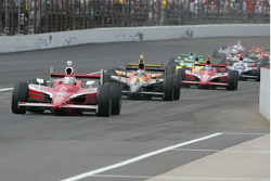 Scott Dixon leads the pack into pit lane