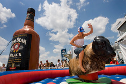 Fans test their skills on the bull at the Jim Beam Hospitality Tent at Lowe's Motor Speedway