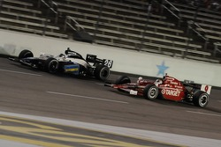 Scott Dixon attempting to pass Marco Andretti
