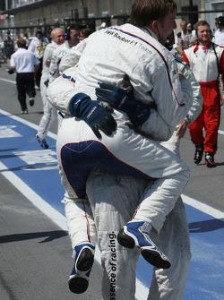 BMW Sauber F1 team members celebrate victory