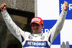 Podium: race winner Robert Kubica celebrates