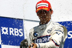 Podium: race winner Robert Kubica