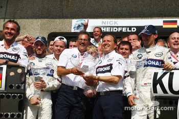 BMW Sauber F1 team celebrations: race winner Robert Kubica celebrates with Nick Heidfeld, Dr. Mario Theissen and BMW Sauber F1 team members