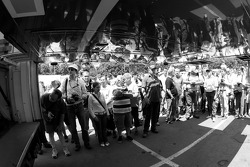 Fans watch the Aston Martin Racing Aston Martin DBR9 unload