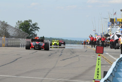 Cars coming into the pits