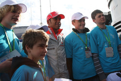 Lewis Hamilton, McLaren Mercedes with some Children
