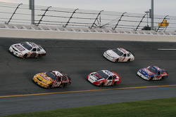 Denny Hamlin and Kyle Busch lead a group of cars