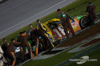 Kyle Busch in the M&M's Toyota gets stuck in the infield while celebrating