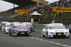 Start: Tom Kristensen, Audi Sport Team Abt, Audi A4 DTM, leads Martin Tomczyk, Audi Sport Team Abt Sportsline, Audi A4 DTM, to the first corner