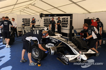 Williams team members prepare the car of Nico Rosberg