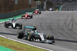 Nico Rosberg, Mercedes AMG F1 leads Lewis Hamilton, Mercedes AMG F1
