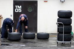 Red Bull Racing mechanics working on Pirelli tires