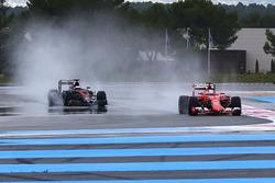 Sebastian Vettel, Ferrari e Stoffel Vandoorne, Mclaren