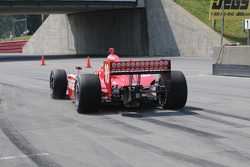 Dan Wheldon leaves the pits