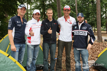The 5 German current F1 drivers, Nico Rosberg, WilliamsF1 Team with Timo Glock, Toyota F1 Team, Sebastian Vettel, Scuderia Toro Rosso, Adrian Sutil, Force India F1 Team and Nick Heidfeld, BMW Sauber F1 Team make a visit to the campsite and a have race to