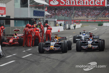 Sébastien Bourdais, Scuderia Toro Rosso, STR03 and David Coulthard, Red Bull Racing, RB4