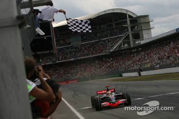 Lewis Hamilton takes the checkered flag
