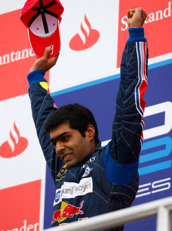 Karun Chandhok celebrates his victory on the podium