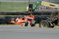Enrique Bernoldi's car is removed from the track in corner 4