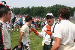 A corner worker tries to break up the argument between Robbie Pecorari, Richard Antinucci and Logan Gomez