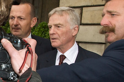 Max Mosley is rushed out of the FIA Place de la Concorde headquarters late in the afternoon after the Extraordinary General Assembly