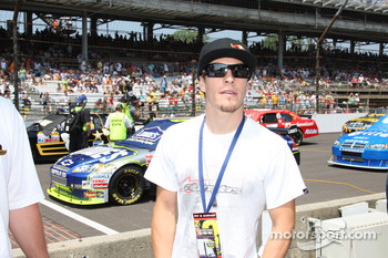 2006 MotoGP champion Nicky Hayden watches pre-race activities