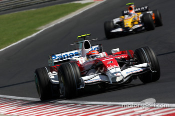 Timo Glock, Toyota F1 Team, TF108 leads Nelson A. Piquet, Renault F1 Team, R28