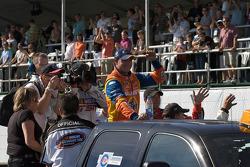 Race winner Andrew Ranger celebrates on his way to the podium