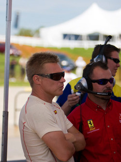 Mika Salo of Risi Competizione looks at timing monitors during qualifying
