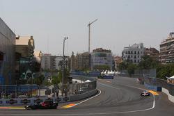 Sebastian Vettel, Scuderia Toro Rosso, STR03 leads Jarno Trulli, Toyota Racing, TF108