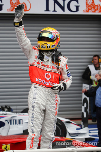Race winner Lewis Hamilton celebrates