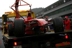 The wrecked Ferrari of Kimi Raikkonen after his crash in the last lap