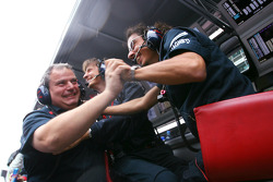 Scuderia Toro Rosso engineers celebrate the pole position of Sebastian Vettel