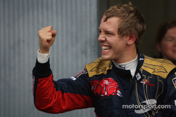 Pole winner Sebastian Vettel celebrates