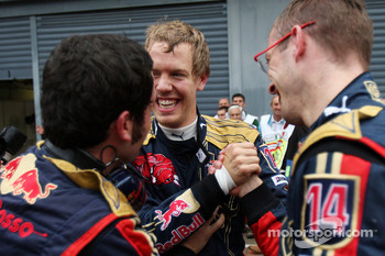 Pole winner Sebastian Vettel celebrates with Sébastien Bourdais