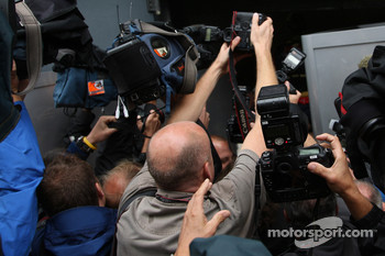 Photographers and cameramen fight for the picture of pole winner Sebastian Vettel celebrating