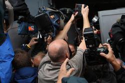 Photographers and cameramen fight for the picture of pole winner Sebastian Vettel celebrating