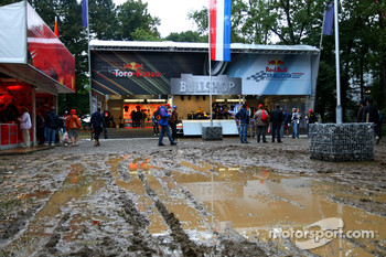 Fan merchandise area deluged with water and mud