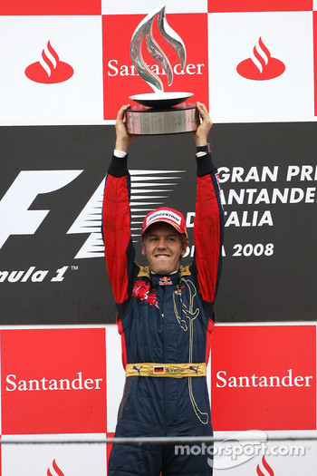 Podium: race winner Sebastian Vettel celebrates