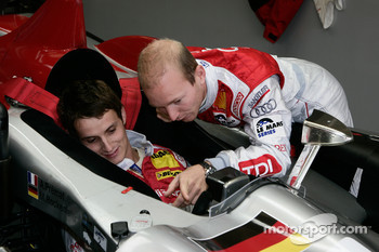 Alexandre Prmat shows his Audi Sport Team Joest Audi R10 TDI to Oliver Jarvis