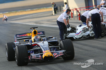Sebastian Vettel, Red Bull Racing, STR03 passes BMW Sauber in the pitlane