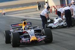 Sebastian Vettel, Red Bull Racing, STR03 passes BMW Sauber in the pitlane