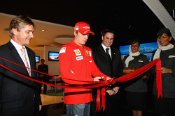 Kimi Raikkonen of Ferrari opens the Etihad Holiday Store at Marina Mall