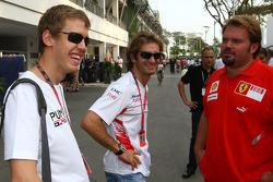 Sebastian Vettel, Scuderia Toro Rosso with Jarno Trulli, Toyota Racing