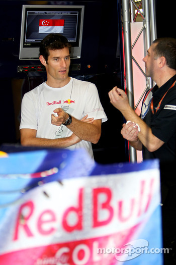 Mark Webber and a crew member